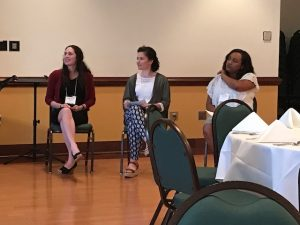 3 graduate students sitting and sharing their stories with the audience